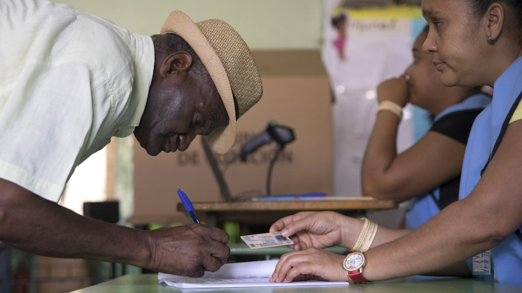 A voter in the 2019 Dominican primary elections. (AP)