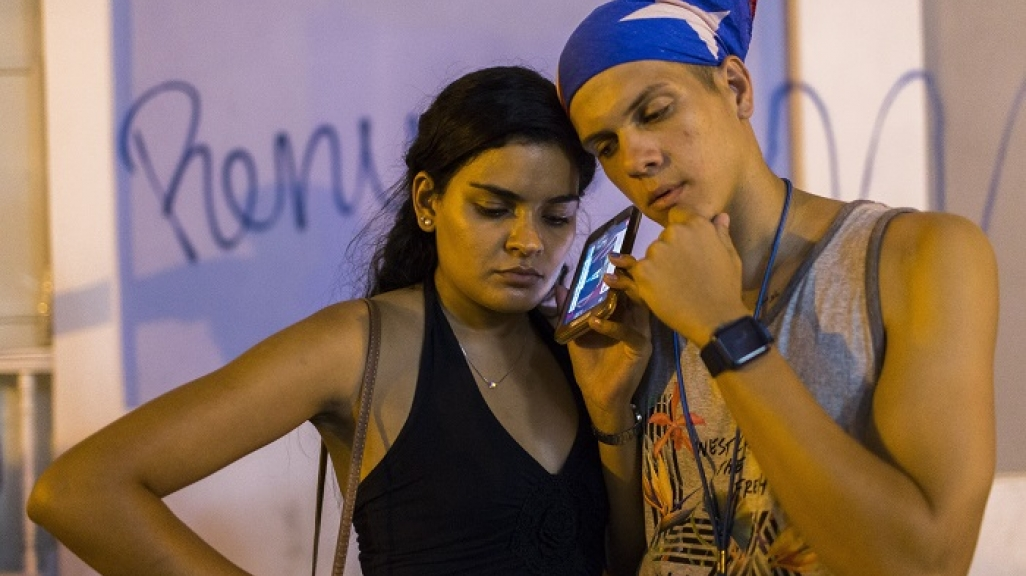 Listening to Rosselló's resignation in San Juan. (AP)