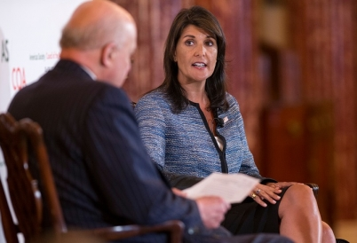 US Ambassador to the UN Nikki Haley talks with John Negroponte at the COA Washington Conference on the Americas
