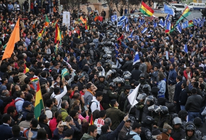 Police separate supporters of opposing candidates in La Paz. (AP)