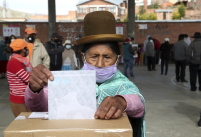 A woman casts a vote in Bolivia's special general elections. (AP)