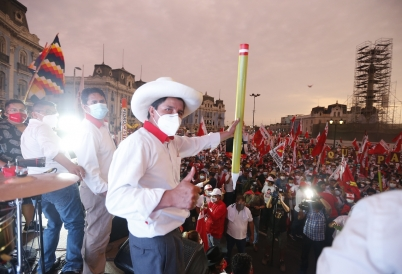Peruvian presidential candidate Pedro Castillo holds his iconic pencil prop at a rally. (AP)