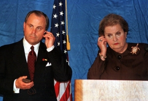 Mack McLarty and Madeleine Albright listen during a press conference in Caracas in 1998. (AP)
